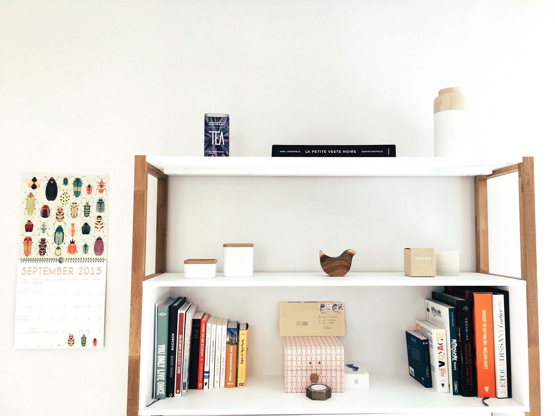 A bookcase with shelves is perfect for storing odds and ends.